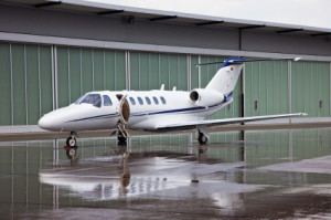 9296818-private-jet-front-of-hangar